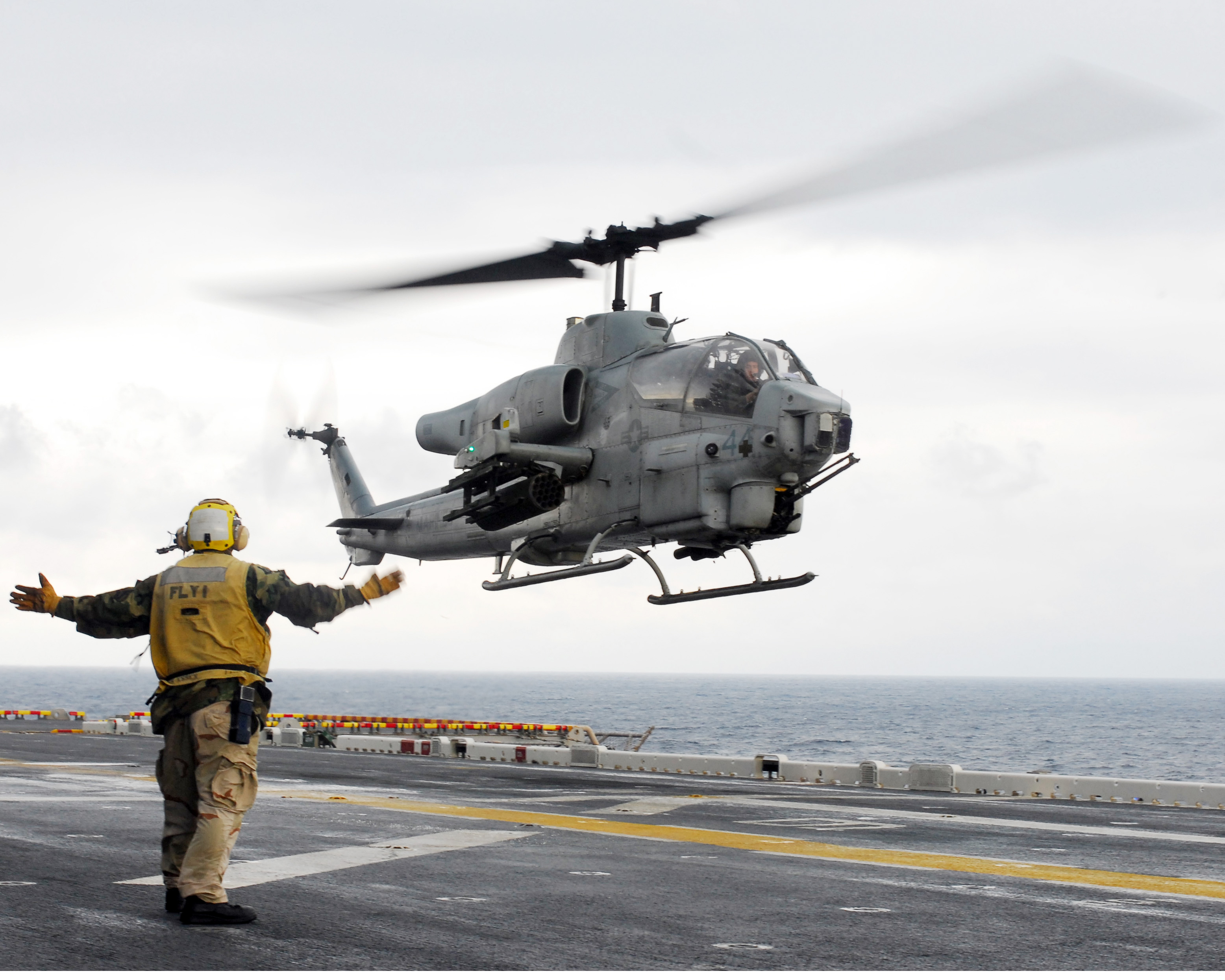marine helicopter with File Us Navy 090127 N 9950j 089 Aviation Boatswain's Mate  Handling  3rd Class Jeffrey Baker  From Davenport  Iowa  Directs The Landing Of An Ah 1z Super Cobra Attack Helicopter on DDH 144 JDS Kurama besides 570883 additionally File US Navy 120119 N UM734 820 Aviation boatswain's mates show flight information to AV 8B pilot Marine Corps Capt  J T  Widmyer  assigned to Marine At moreover 438904 also File Marine One  South lawn and the Washington Monument.