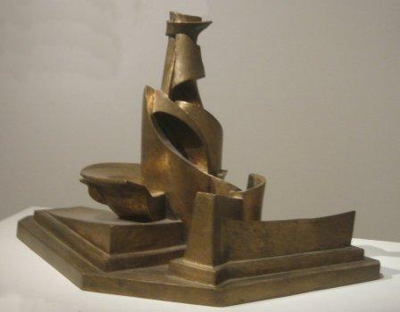 http://upload.wikimedia.org/wikipedia/commons/9/9e/%27Development_of_a_Bottle_in_Space%27%2C_bronze_sculpture_by_Umberto_Boccioni%2C_1913%2C_Metropolitan_Museum_of_Art.jpg