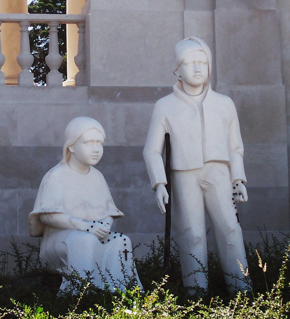 Grey statutes of the Fatima children, Jacinta (seated) and Francisco (standing_