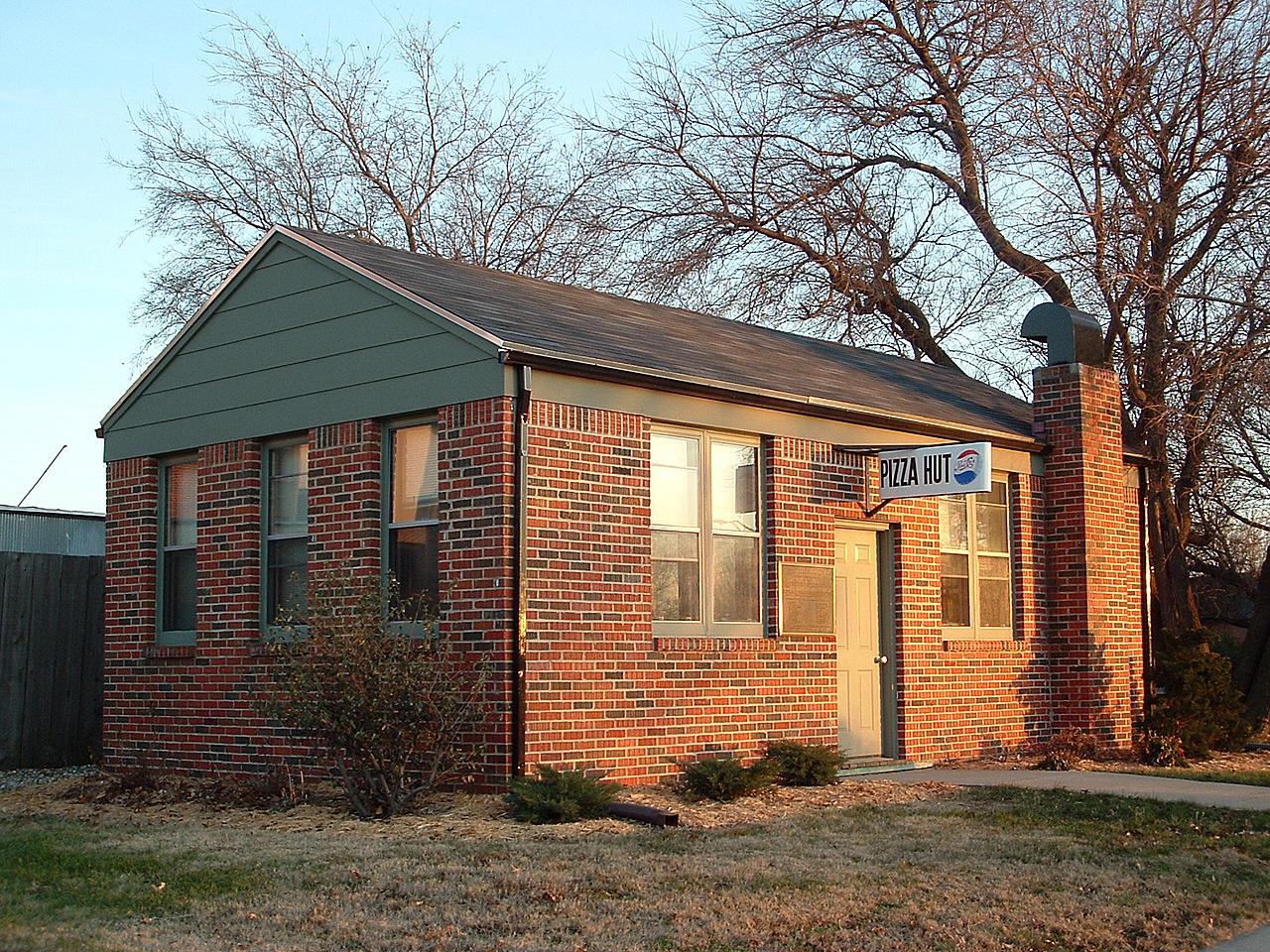 The original Pizza Hut building, opened on June 15, 1958 at the corner of Kellogg and Bluff by brothers Frank and Dan Carney, both students at Wichita State University. This photo is from 2004, after the building had been moved to the campus. Cf. Wikipedia