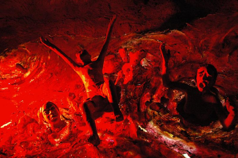 Image is of several people suffering in a pit of lava. Lava pit, Hell, Haw Par Villa, Singapore by Jpatokal / Wikimedia Commons.