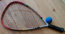 Racquetball a racquet sport played with a hollow rubber ball in an indoor or outdoor court.