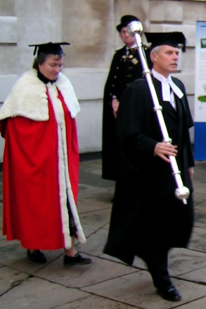 The Vice-Chancellor of the University of Cambridge's deputy wearing the cope (cappa clausa) led by an Esquire Bedell. - Academic dress