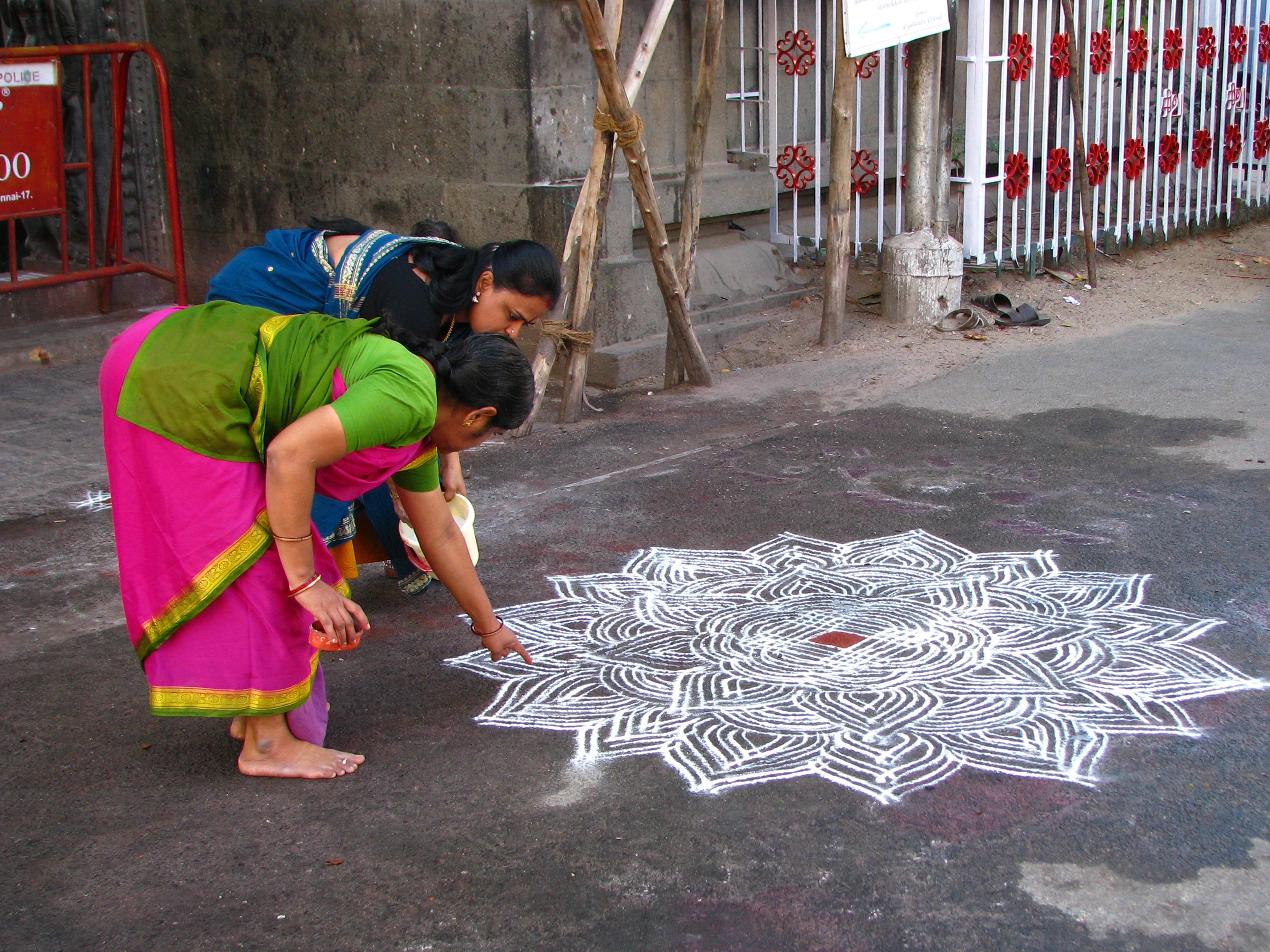 File:India - Sights & Culture - Women drawing an intricate kolam ...