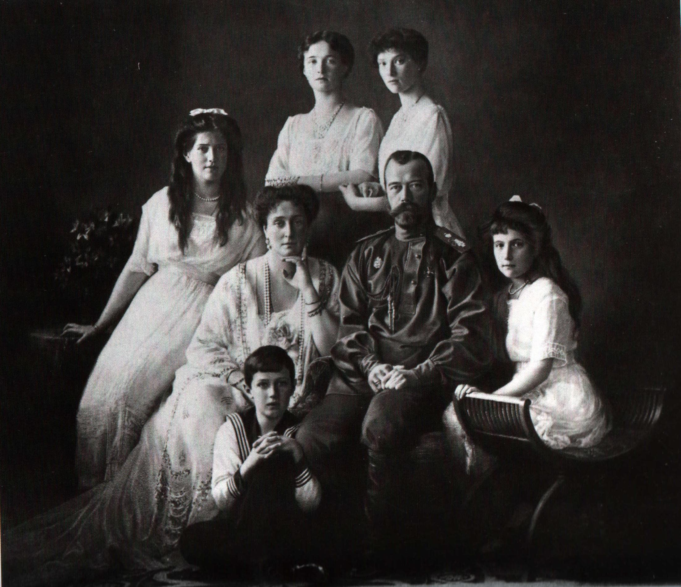 The Russian imperial family, 1913. Left to right: Grand Duchess Maria, Tsarina Alexandra, Grand Duchesses Olga and Tatiana, Tsar Nicholas II, and Grand Duchess Anastasia. Tsarevich Alexei sits in front of his parents.