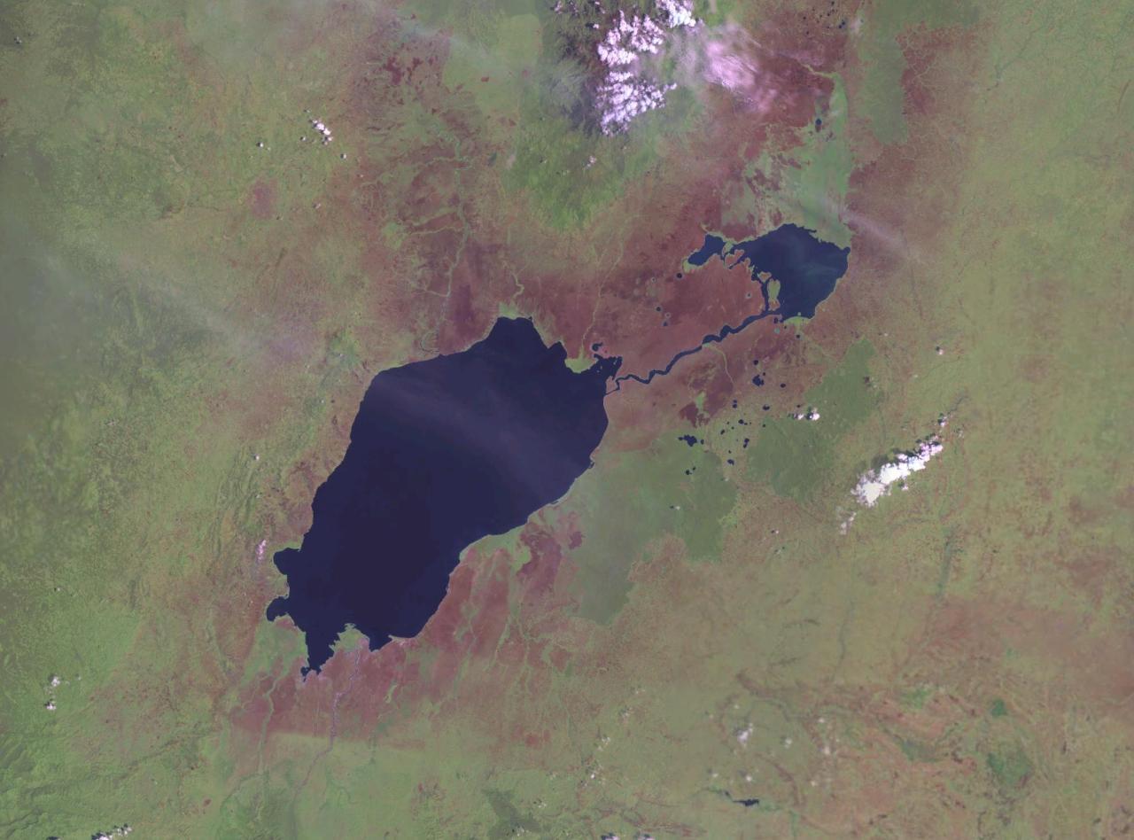 NASA Landsat photo of Lake Edward (left) and smaller [[Lake George (Uganda)|Lake George]] with the Kazinga Channel between them