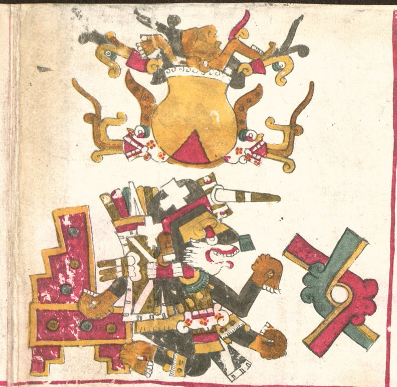 A page from the Codex Borgia, it is a complicated drawing difficult to describe in alt text. Top of the page: A yellow and red pot flanked by skulls, filled with various objects and topped by a human face. Beneath pot: an elaborate dog-human hybrid figure kneeling in front of a stool or throne and facing an Aztec letter (Ollin)represented as two interlocking angles, one in red and the other in green and both accented with a stripe of yellow stripe along the interior fo the angle..