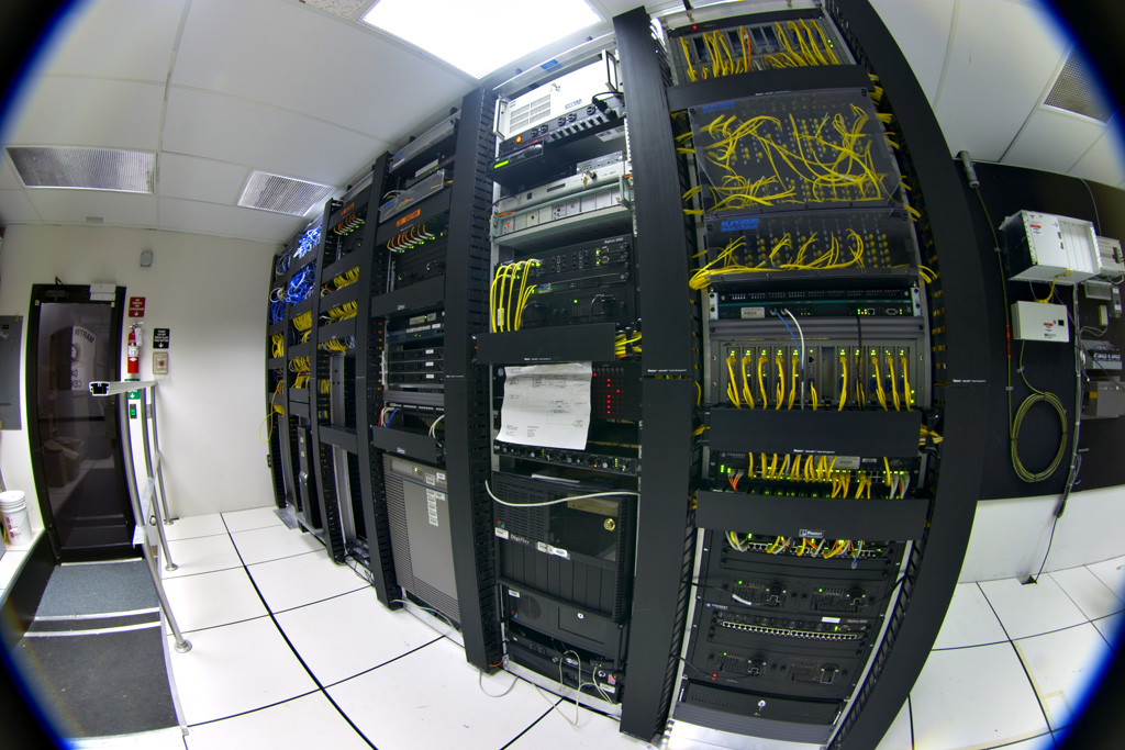 Telecommunications equipment in one corner of a small data center. Contributed and licensed under the GFDL by the photographer, Gregory Maxwell. https://commons.wikimedia.org/wiki/File:Datacenter-telecom.jpg