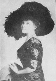 Image of profile of Grace Drayton, wearing a large feathered hat.