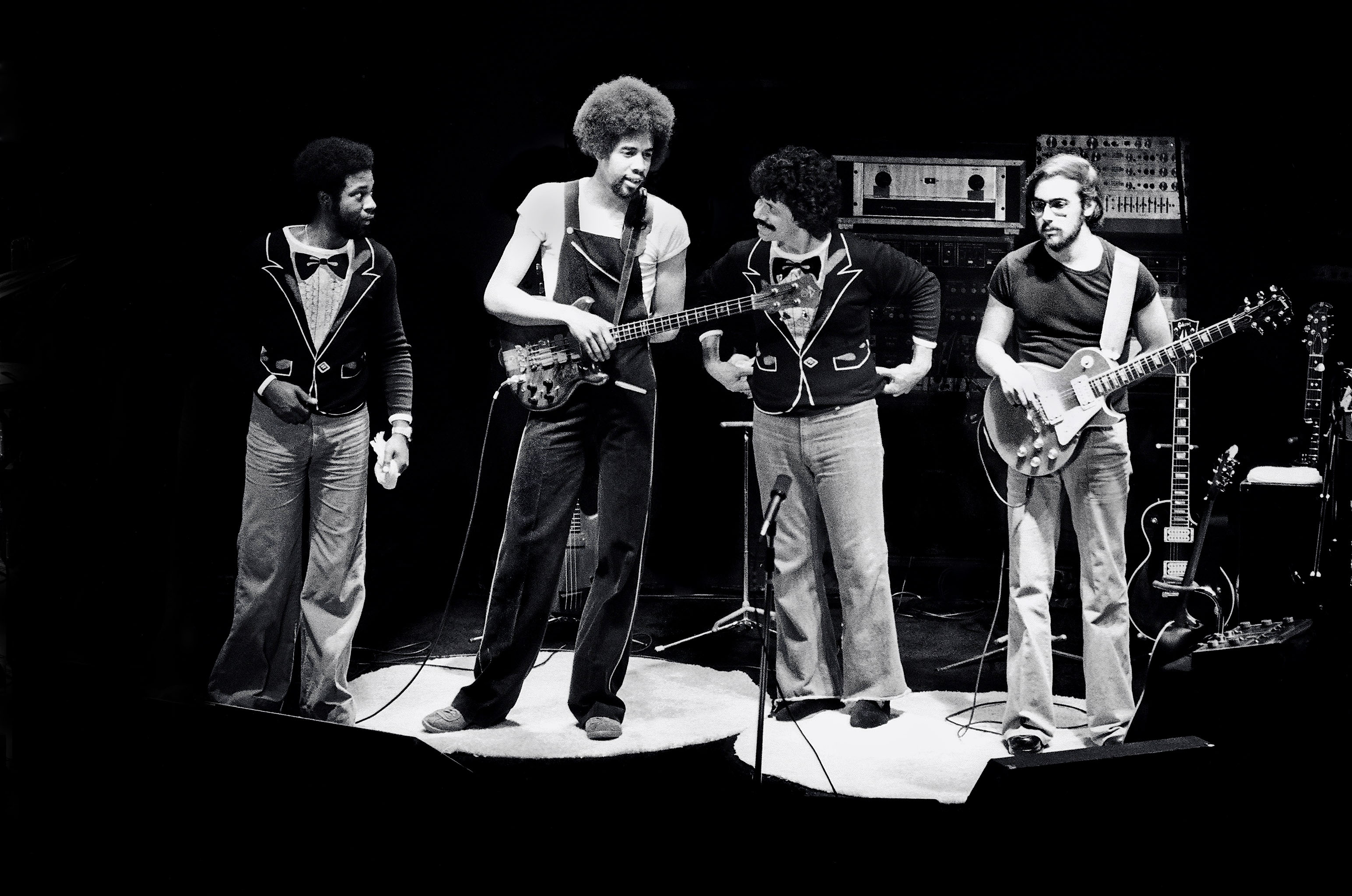 Black and white photo of the Return to Forever band on stage.