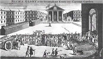 """Rich's Glory"": John Rich seemingly invades his new Covent Garden Theatre. (caricature by William Hogarth) Rich-Covent-Garden.jpg"