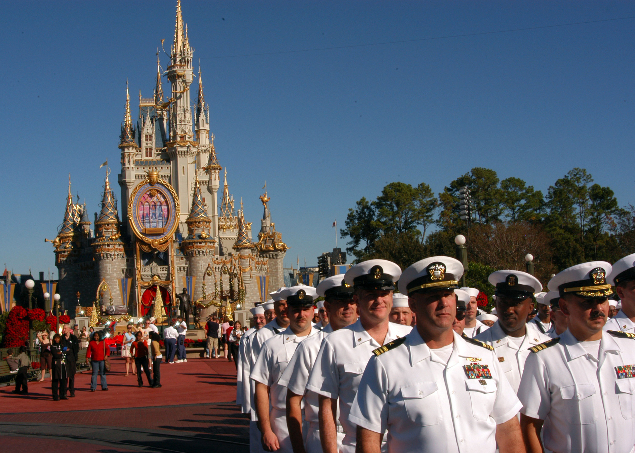 filesailors from various us navy commands throughout navys southeast region march before cinderellas castle