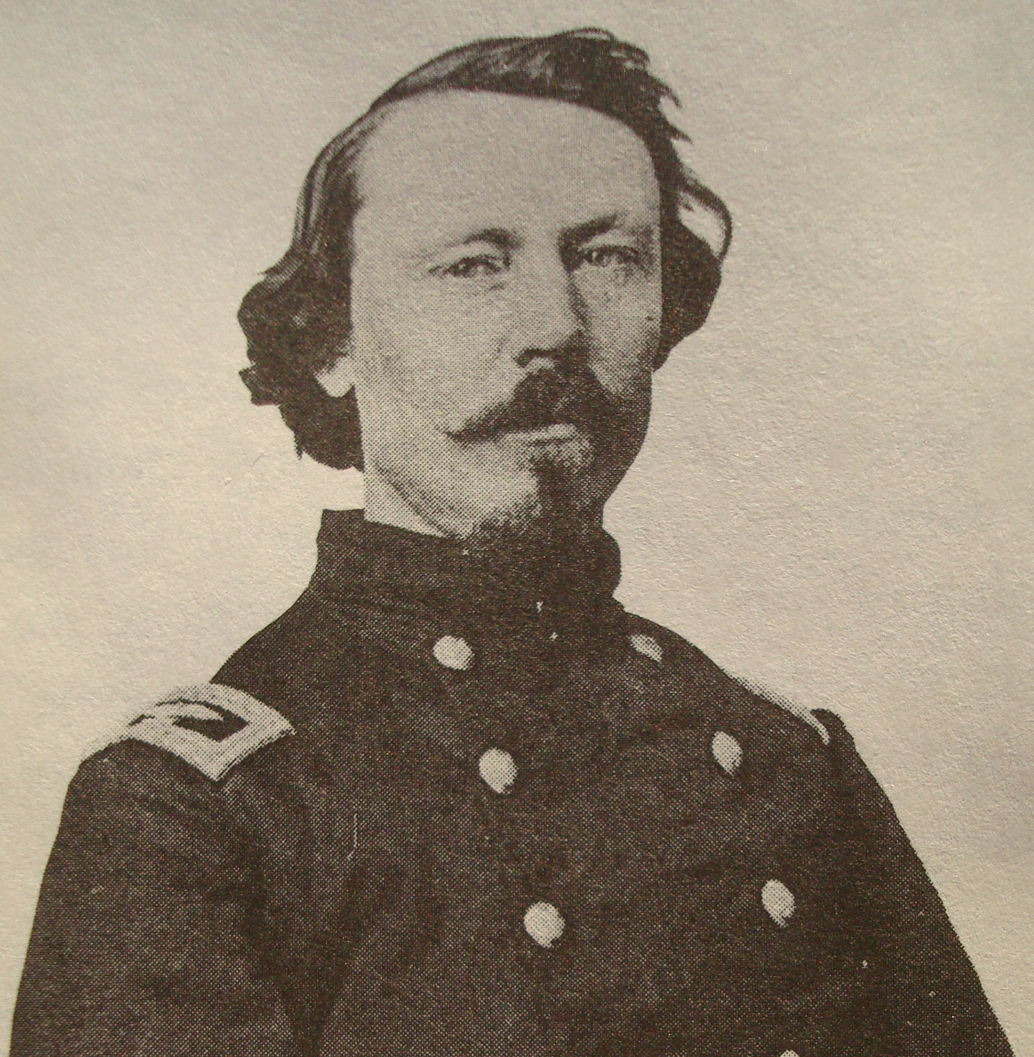 Patrick E . Burke