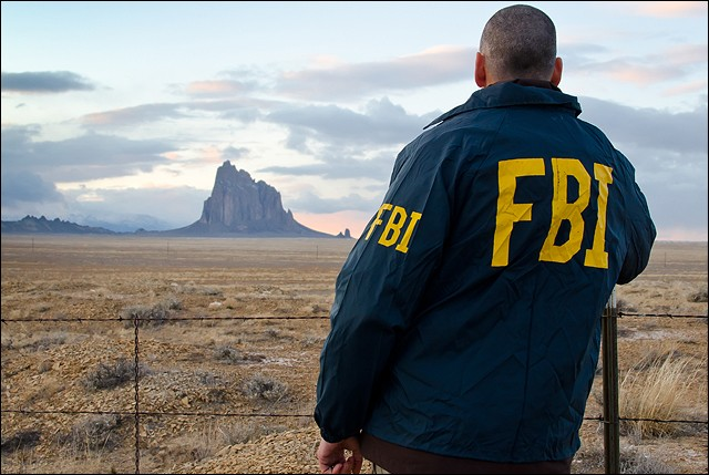 Image courtesy of https://commons.wikimedia.org/wiki/File:FBI_agent_overlooking_the_Shiprock_land_formation_on_the_Navajo_Nation.jpg