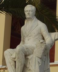 פסלו של קפודיסטריאס, בחזית אוניברסיטת אתונה הנקראת על שמו