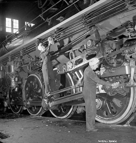 Women replaced men in many of the roundhouse jobs during World War II. Photo taken January, 1943. Locomotive fast freight cleaning.png
