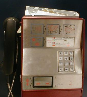Payphone with slide for coins