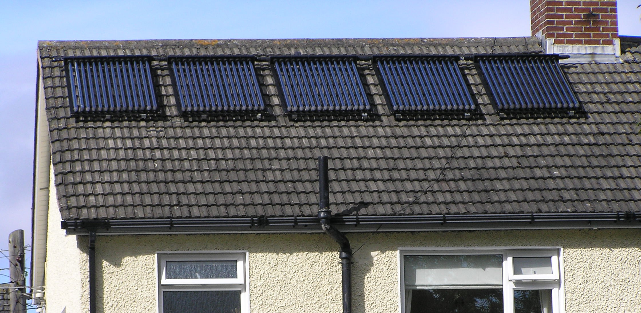Description Solar Hot Water Panels On Suburban House Roof South Dublin ...
