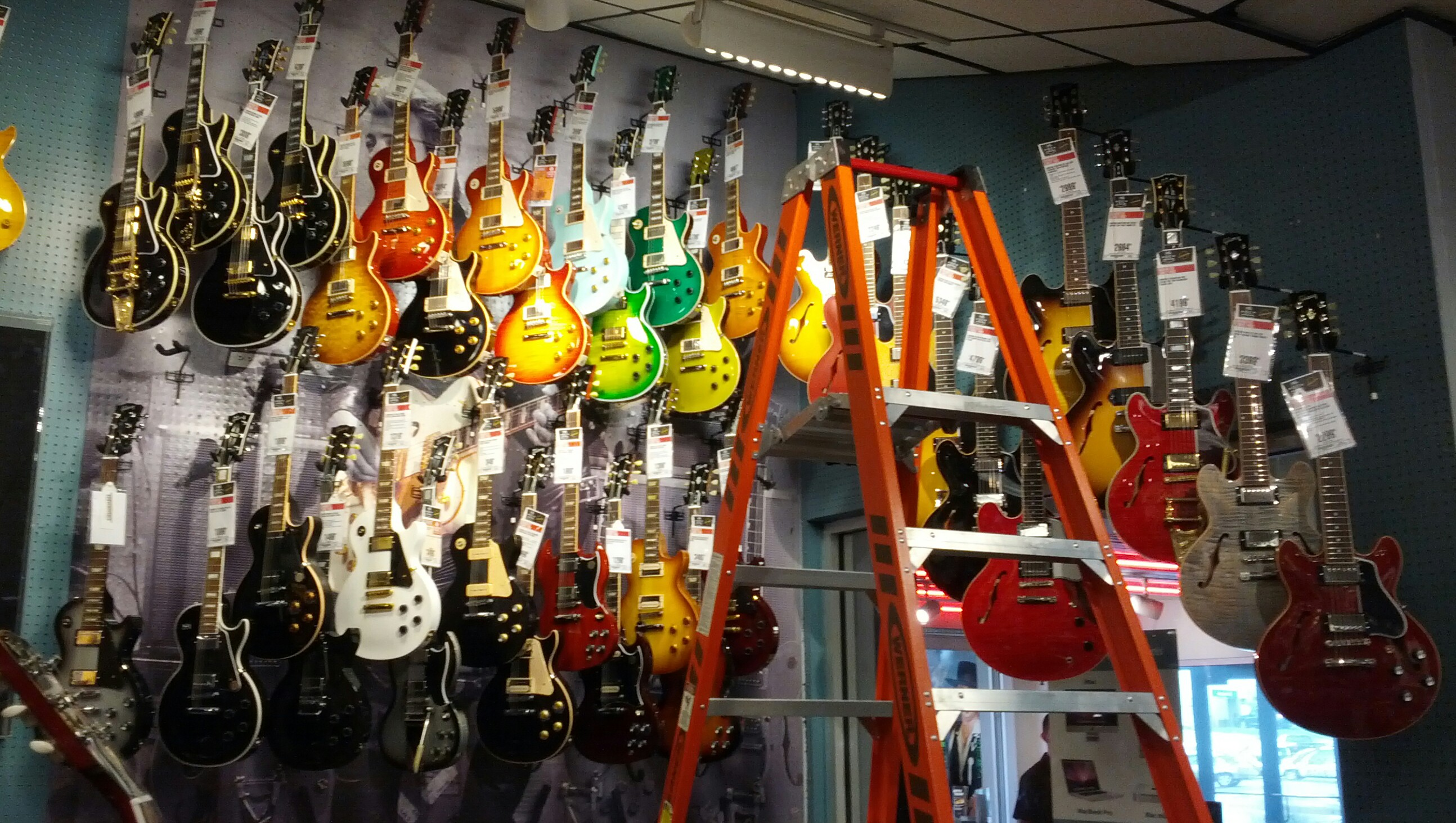 file wall of gibson guitars guitar center allandale austin. Black Bedroom Furniture Sets. Home Design Ideas