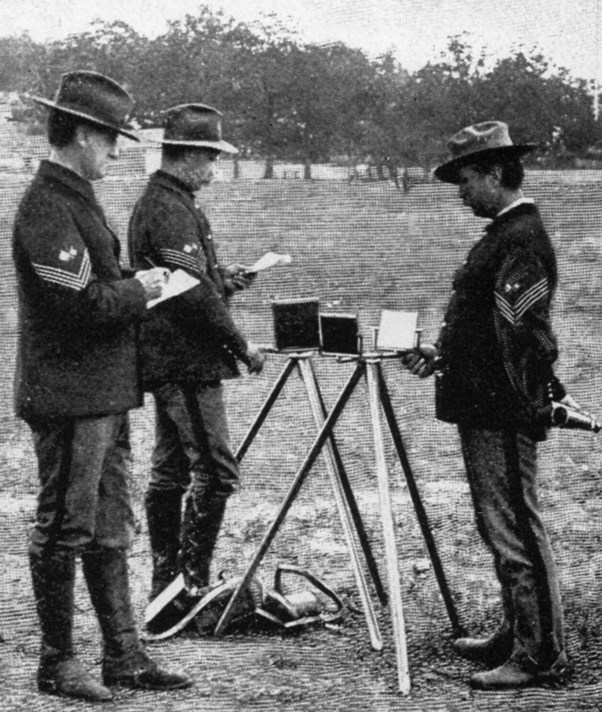 A combination photo/engraving (photo with backdrop replaced by engraving) of US Army Signal Corps personnel training with Heliograph ca July 1898 while waiting to be sent to Cuba for the Spanish-American War.