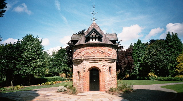 Dovecote in Walkden Gardens, Sale, Greater Manchester. The dovecote is the only remaining building of Sale Old Hall, which was demolished in the 1930s. The dovecote was moved in 2003 from its original location a mile away at Junction 6 of the M60, and rebuilt brick by brick in Walkden Gardens in 2004.