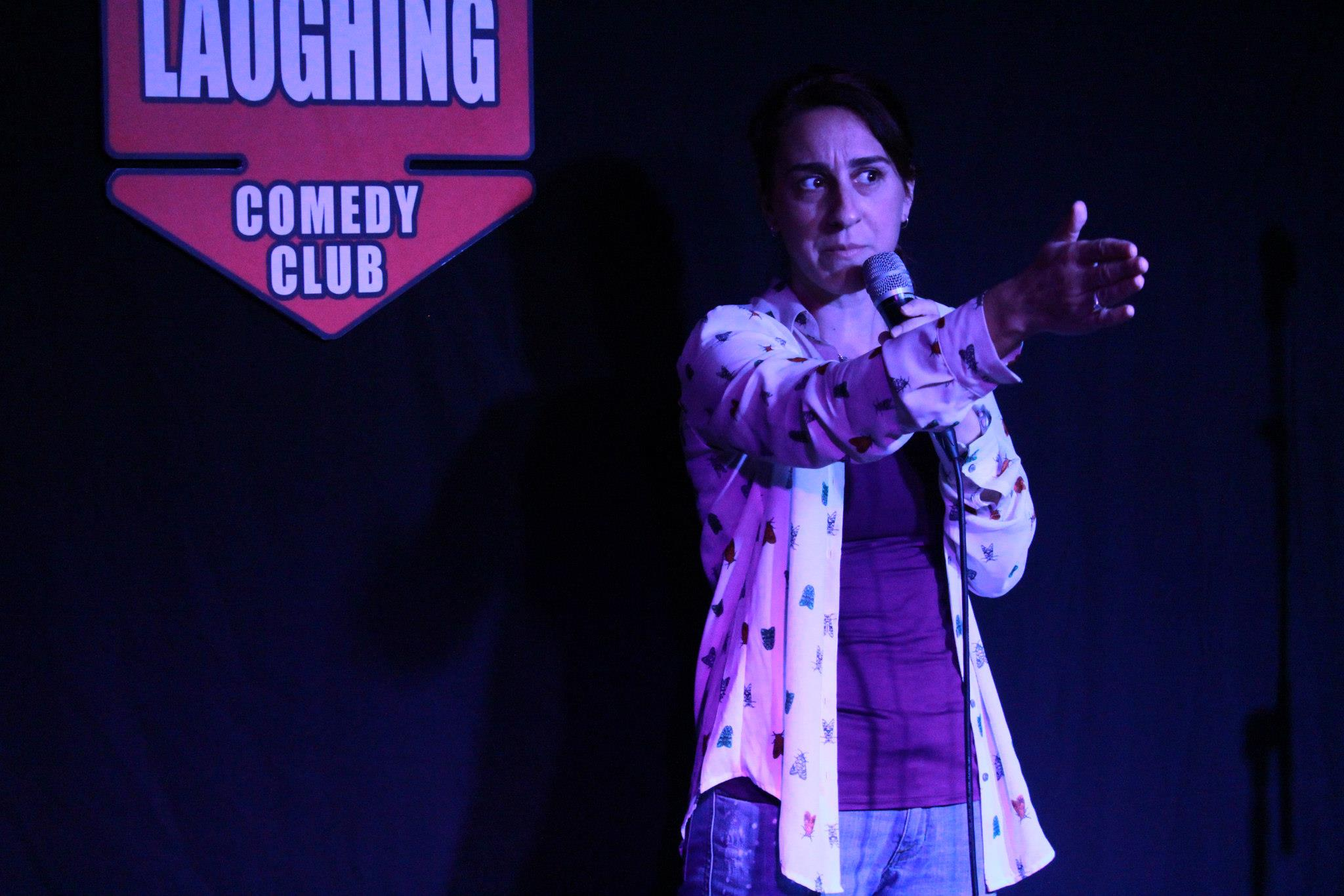 Jess Pratt performing at her student graduation show at The Dubai Laughing Comedy Club.jpg