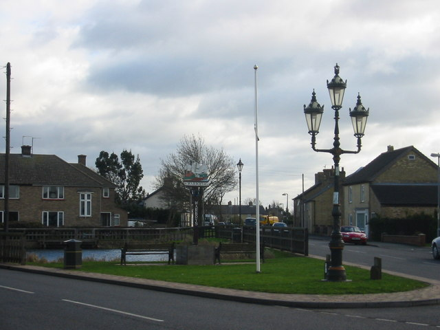 File:Pond, sign, flagpost and fancy streetlamp - geograph.org.uk - 350628.jpg