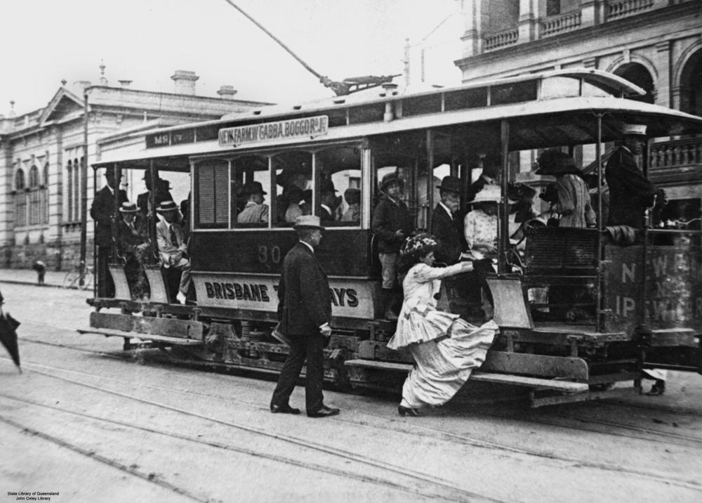 File Statelibqld 1 48448 Woman Getting On A Tram Brisbane