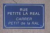 Perpignan street name sign in French and Catalan.