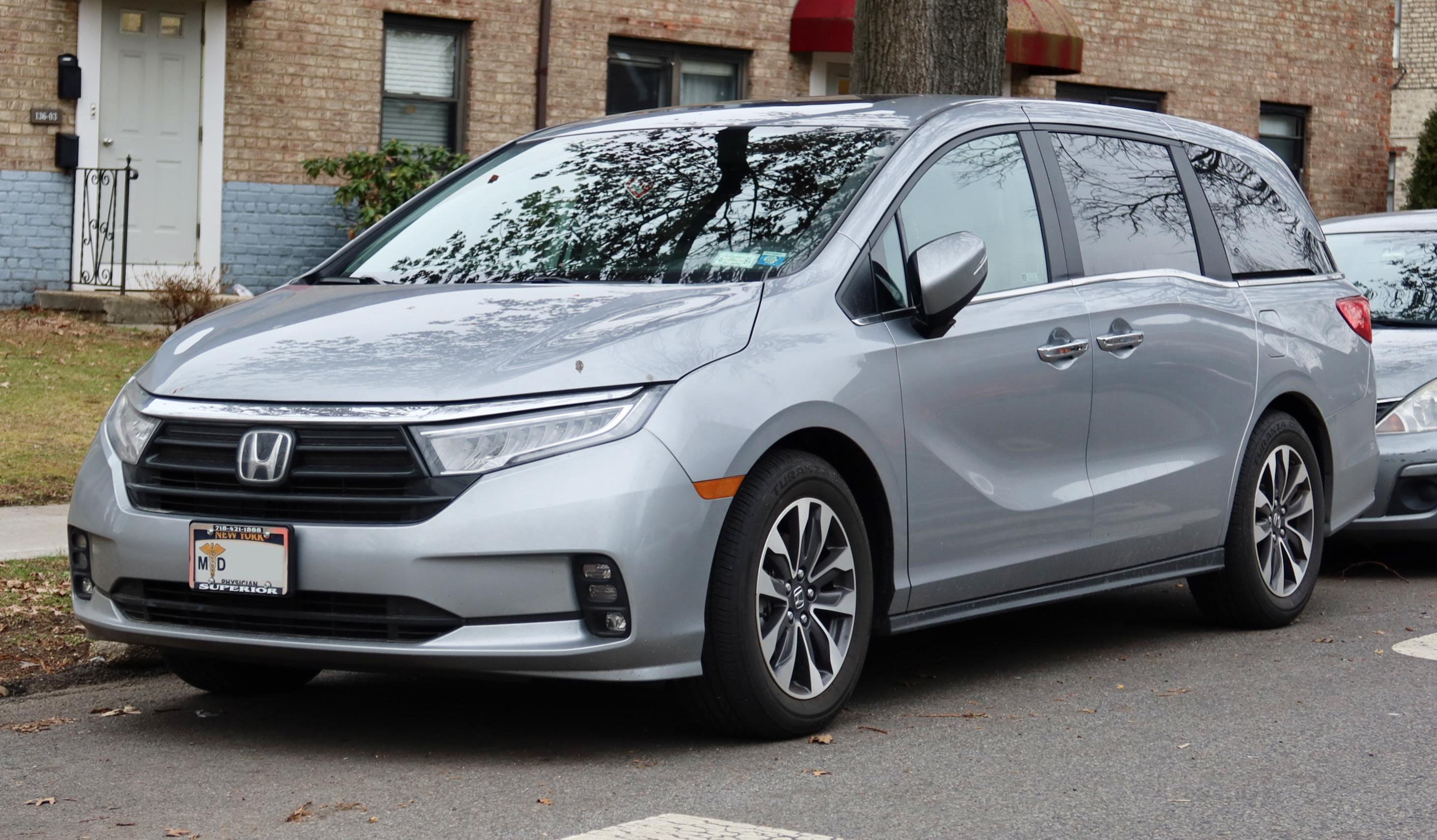 Silver Honda Odyssey parked on a street