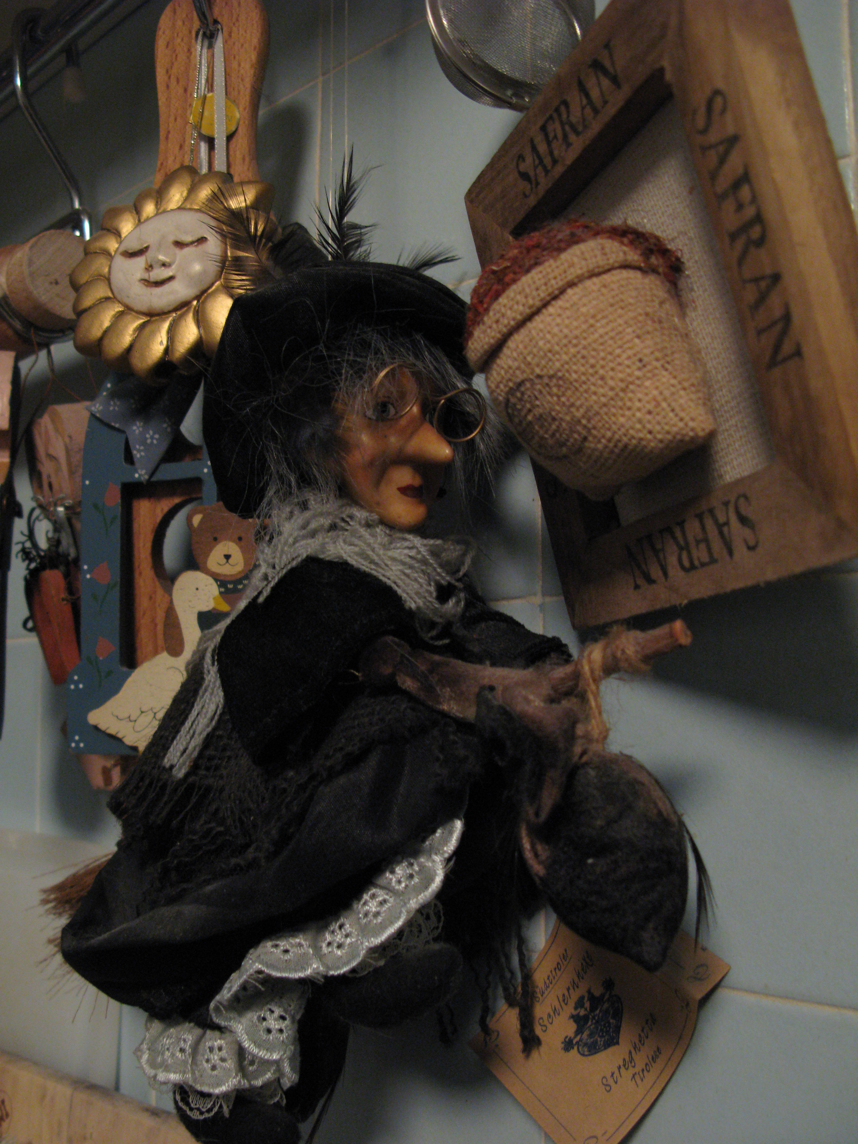 An image of La Befana riding a broomstick.