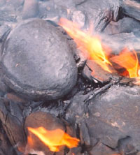 Image of naturally burning oil shale on a coas...