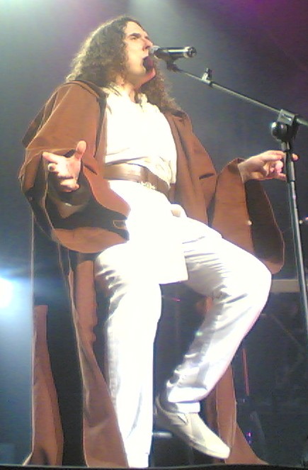 """Weird Al Yankovich performing """"The Saga Begins,"""" dressed as a Jedi Knight."""