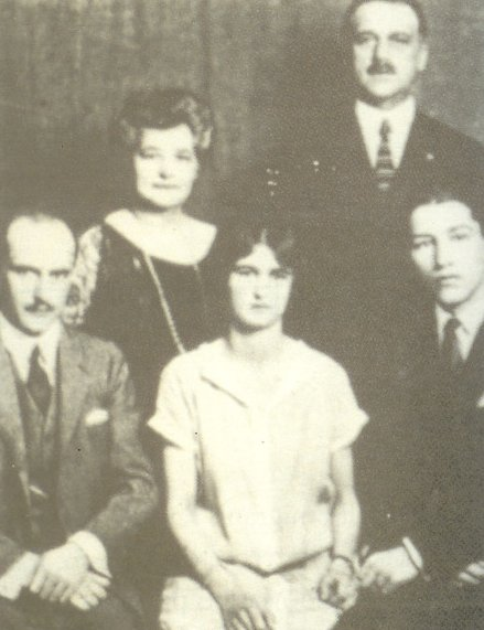 Claire Giannini (c. 1920) in center with parents and brothers Lawrence and Virgil