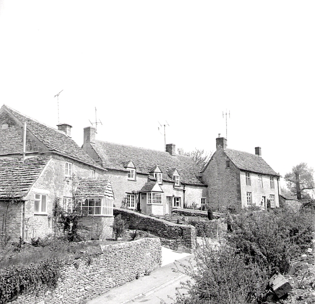 Cottages at Ampney Crucis. The copyright on this image is owned by Alan Longbottom and is licensed for reuse under the Creative Commons Attribution-ShareAlike 2.0 license.