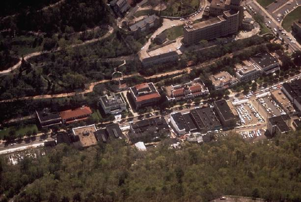 Aerial view of Hot Springs National Park showing the historic Bathhouse Row. Fourth from the left is the Fordyce Bathhouse which serves as the park visitor center. Hots Springs National Park aerial.jpg