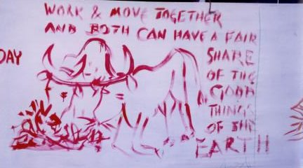 Red painting on white background of two oxen yoked together, feeding on plants, beneath the words,