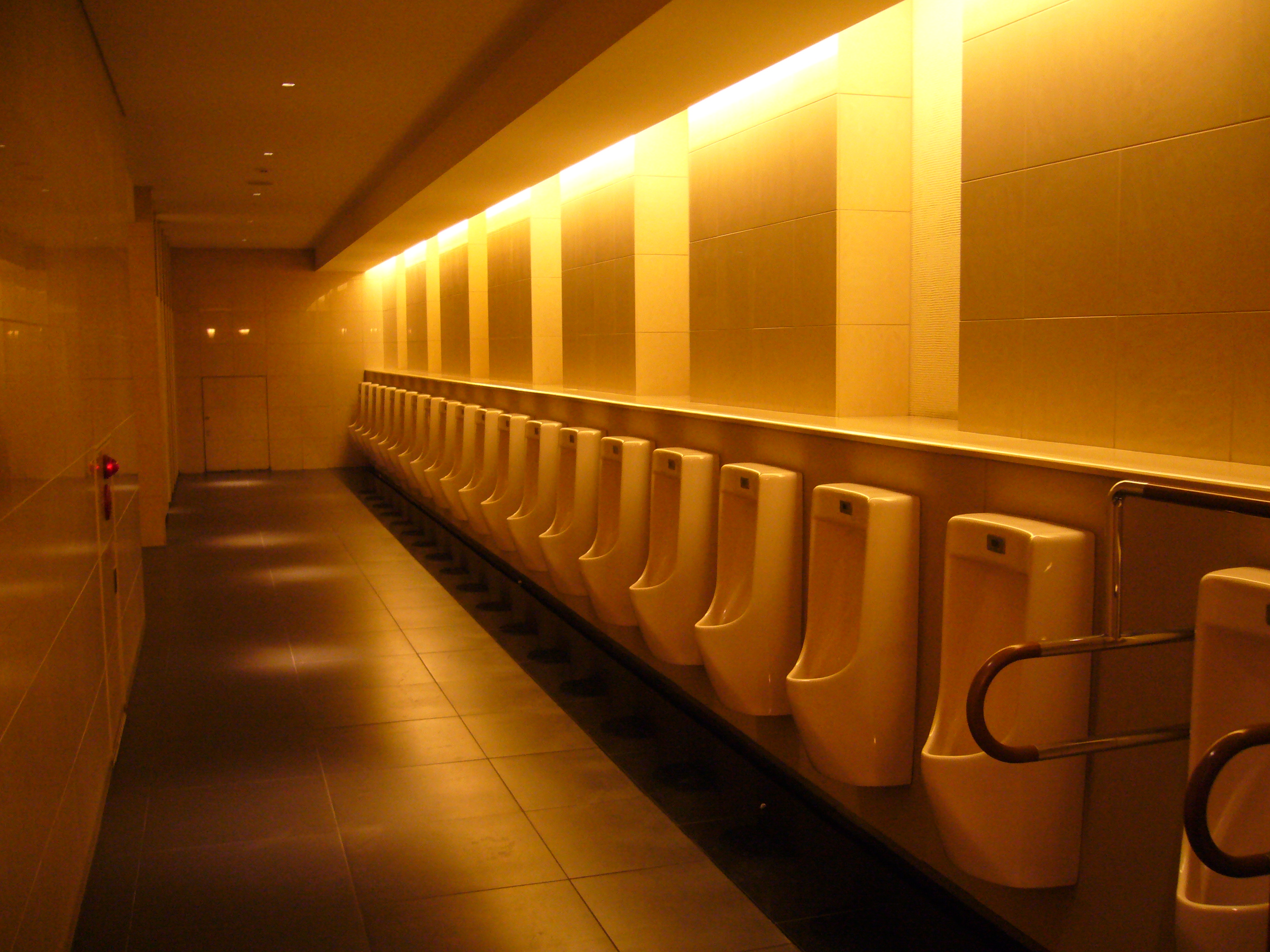 File:Many urinals rows with amber lighting in the Tokyo Cinema\'s ...