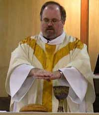 A Methodist minister consecrating the Eucharist elements during the Service of the Word and Table