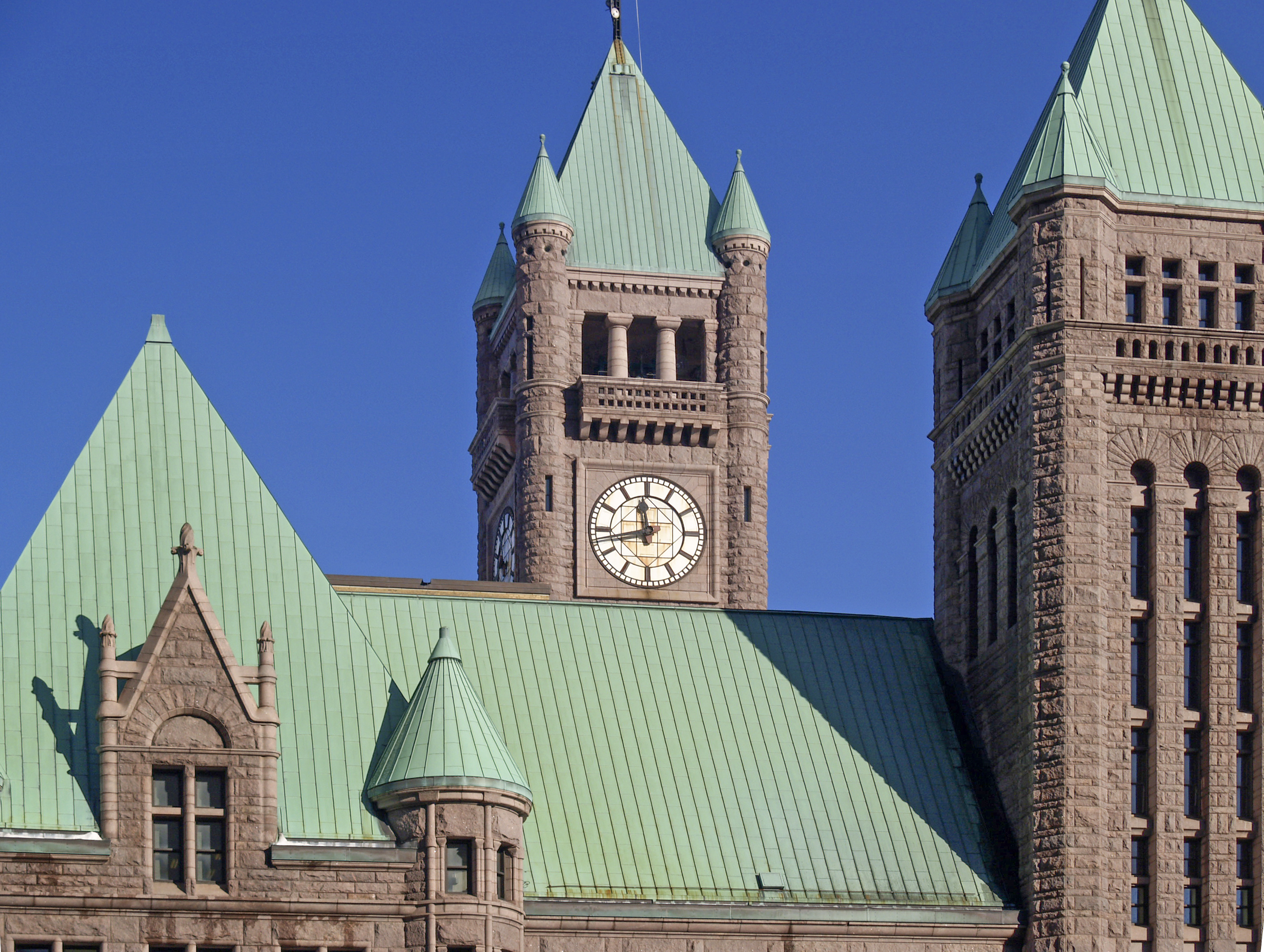 Four of city hall's turrets seen near the roof