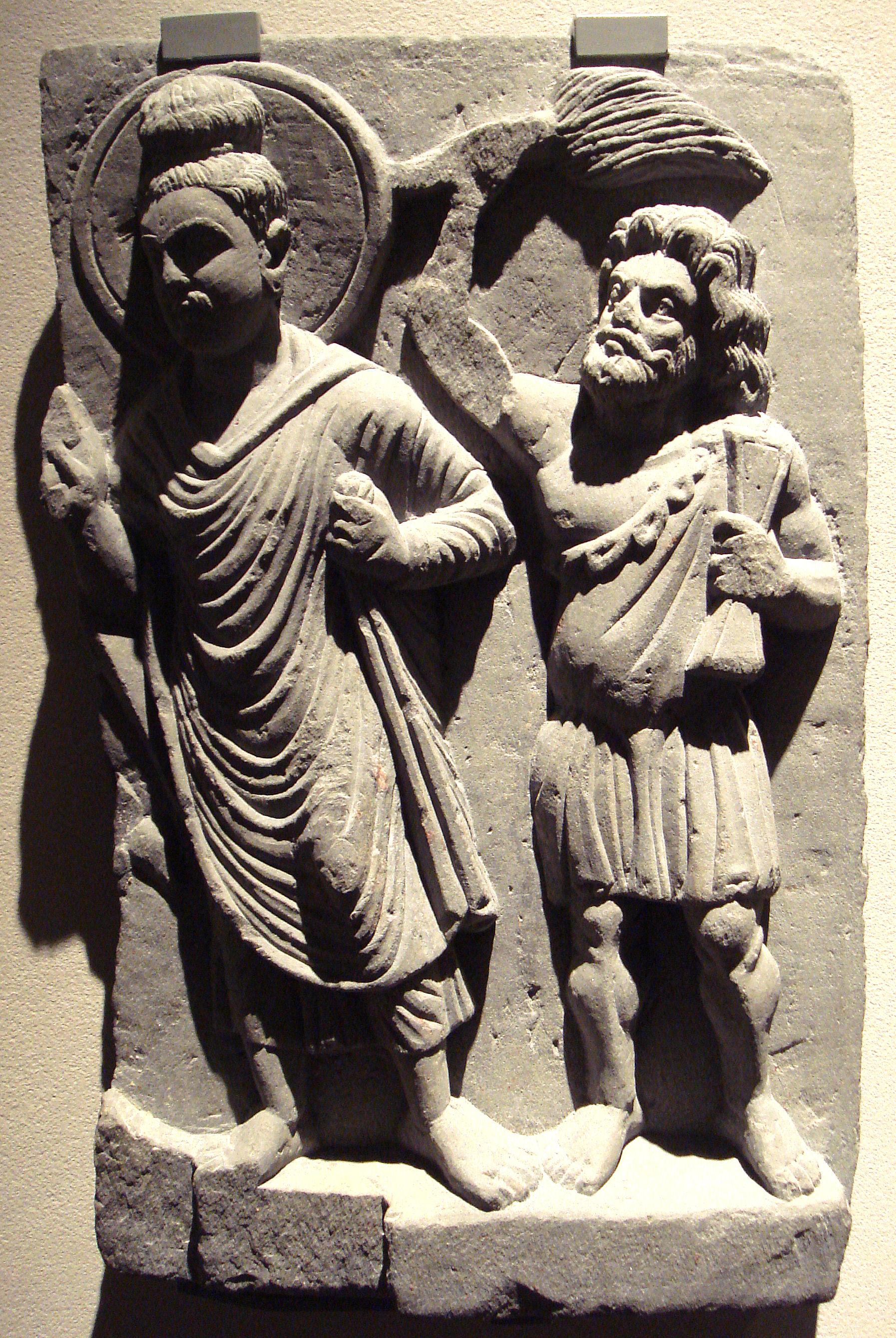 Buddha with his protector Vajrapani, Gandh ra, 2nd century CE, Ostasiatische Kunst Museum