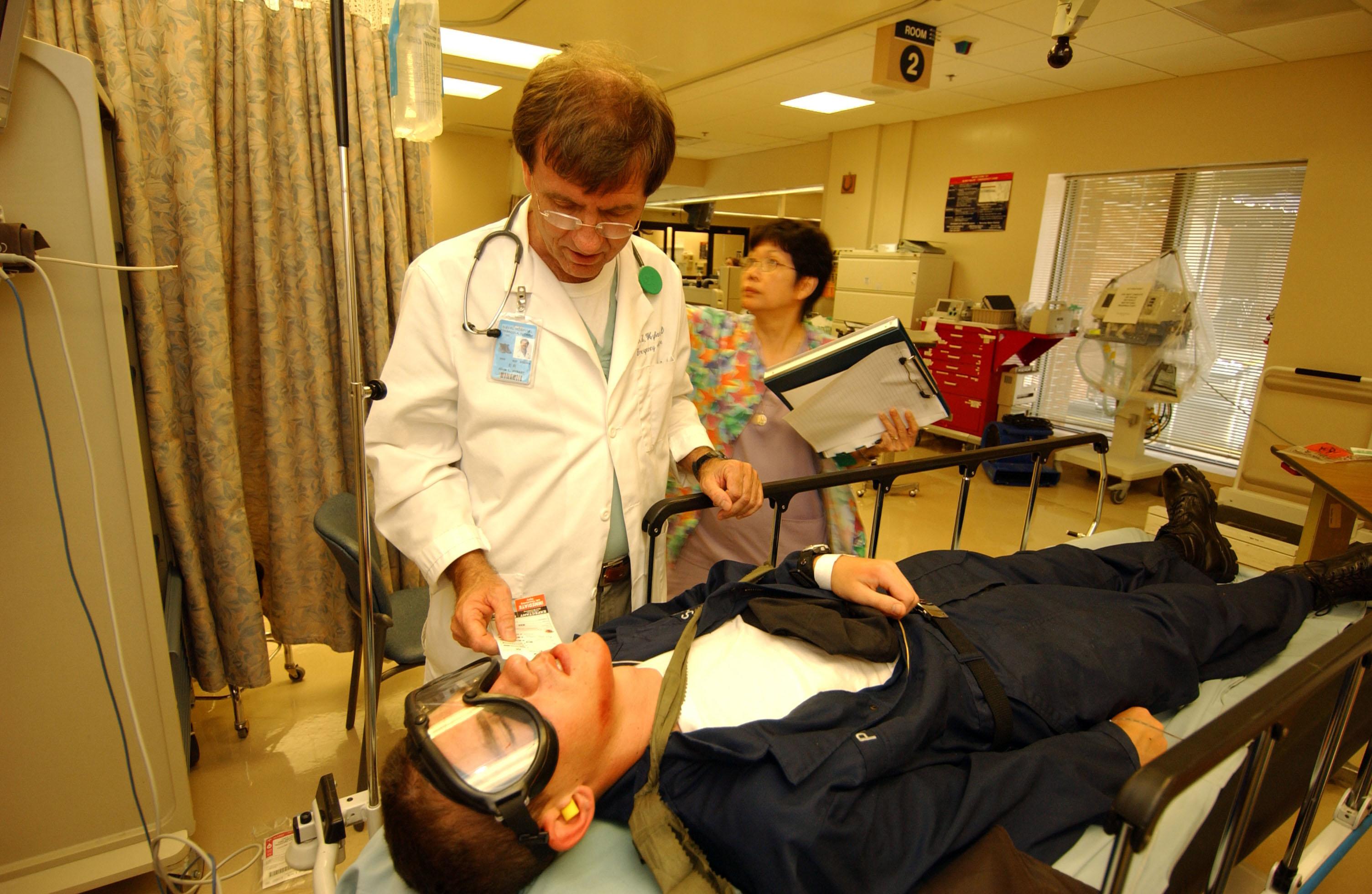 FileUS Navy 050526F5586B100 Medical Director Emergency – Medical Evaluation