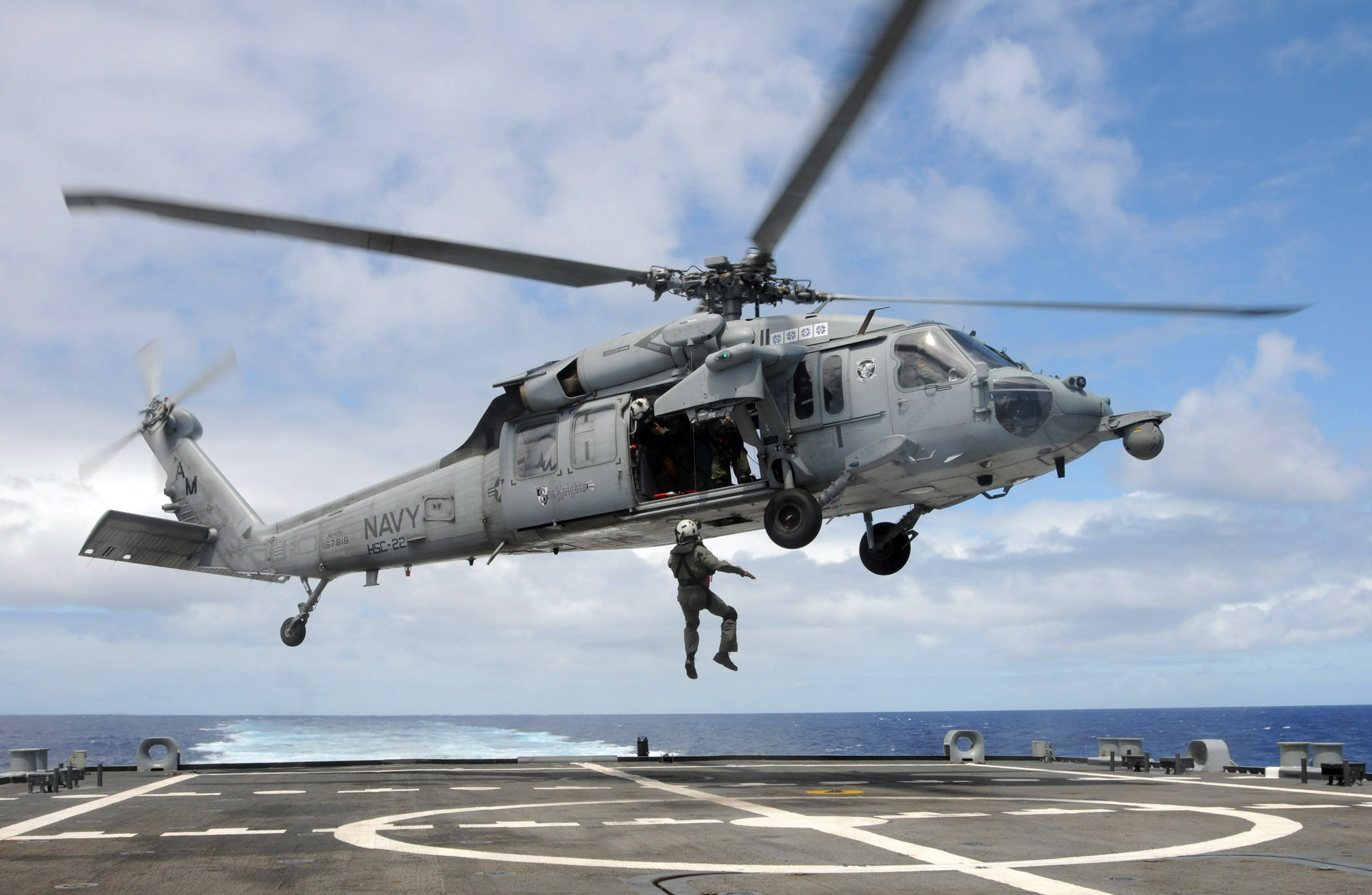 FileUS Navy 100622 N 7058E 314 A Naval Aircrewman Assigned To Helicopter Sea Combat Squadron HSC 22 Is Hoisted Into An MH 60S Hawk From