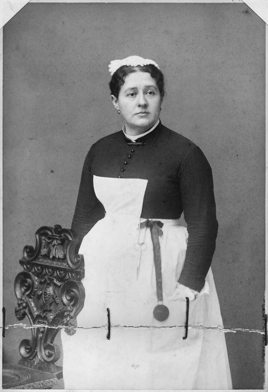 Unidentified_woman_in_maid%27s_uniform._