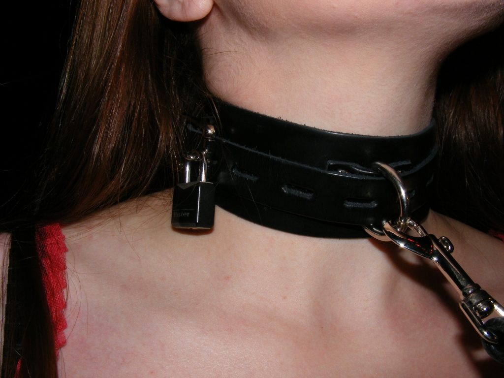 Woman leash on slave collar