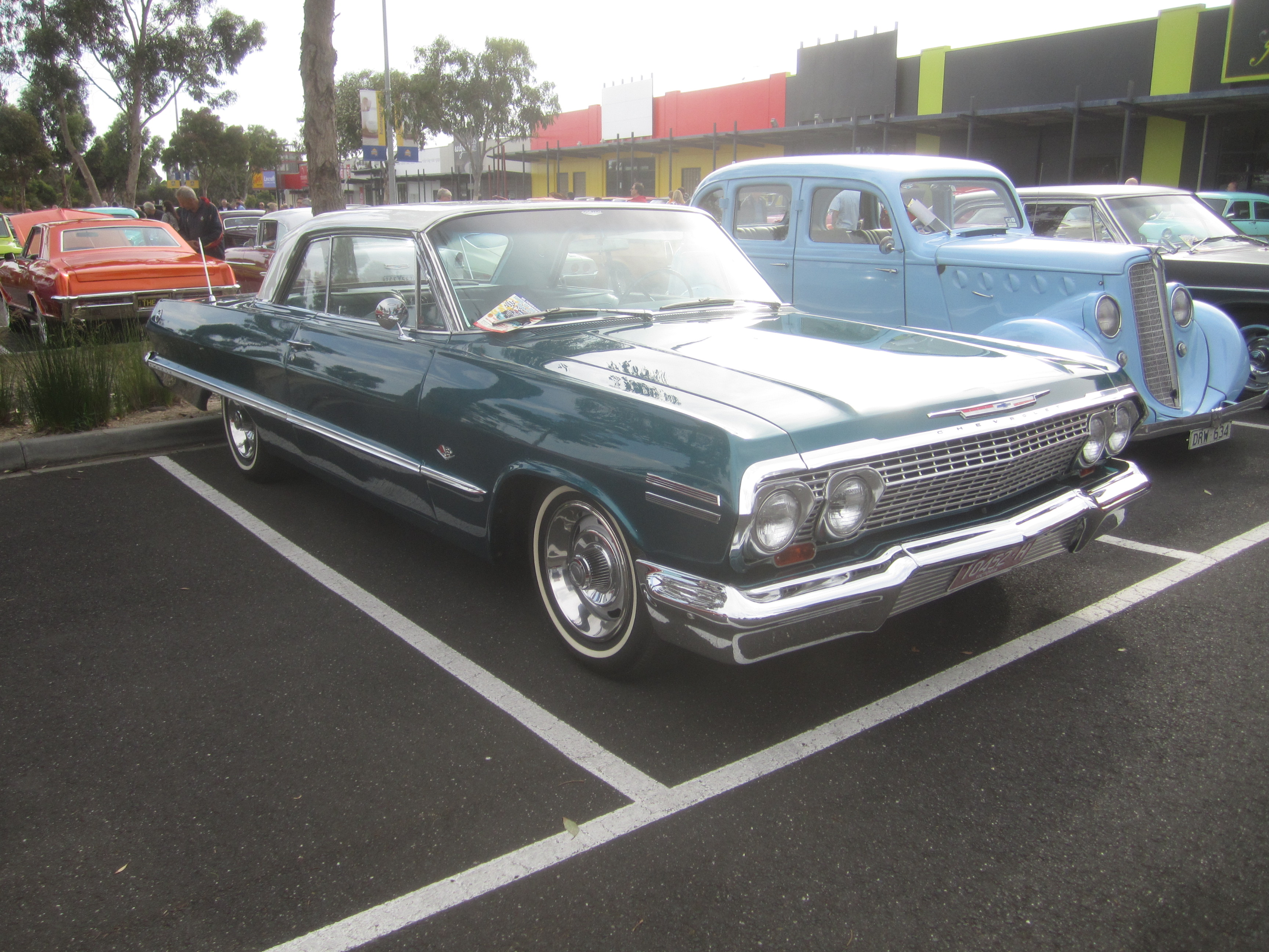 File 1963 Chevrolet Impala 2 door Hardtop also 22 Platinum Shield Chrome Rims Wheels 245 30zr22 Tires Set 5 A 6699 likewise 47147127323821483 also Dodge Charger And Dodge Challenger as well Mustang. on 03 impala with rims