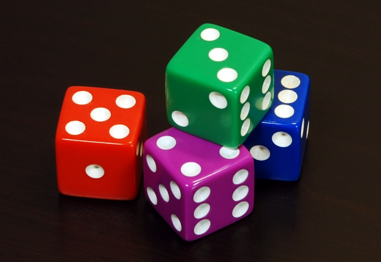 Four Colored Traditional Dice