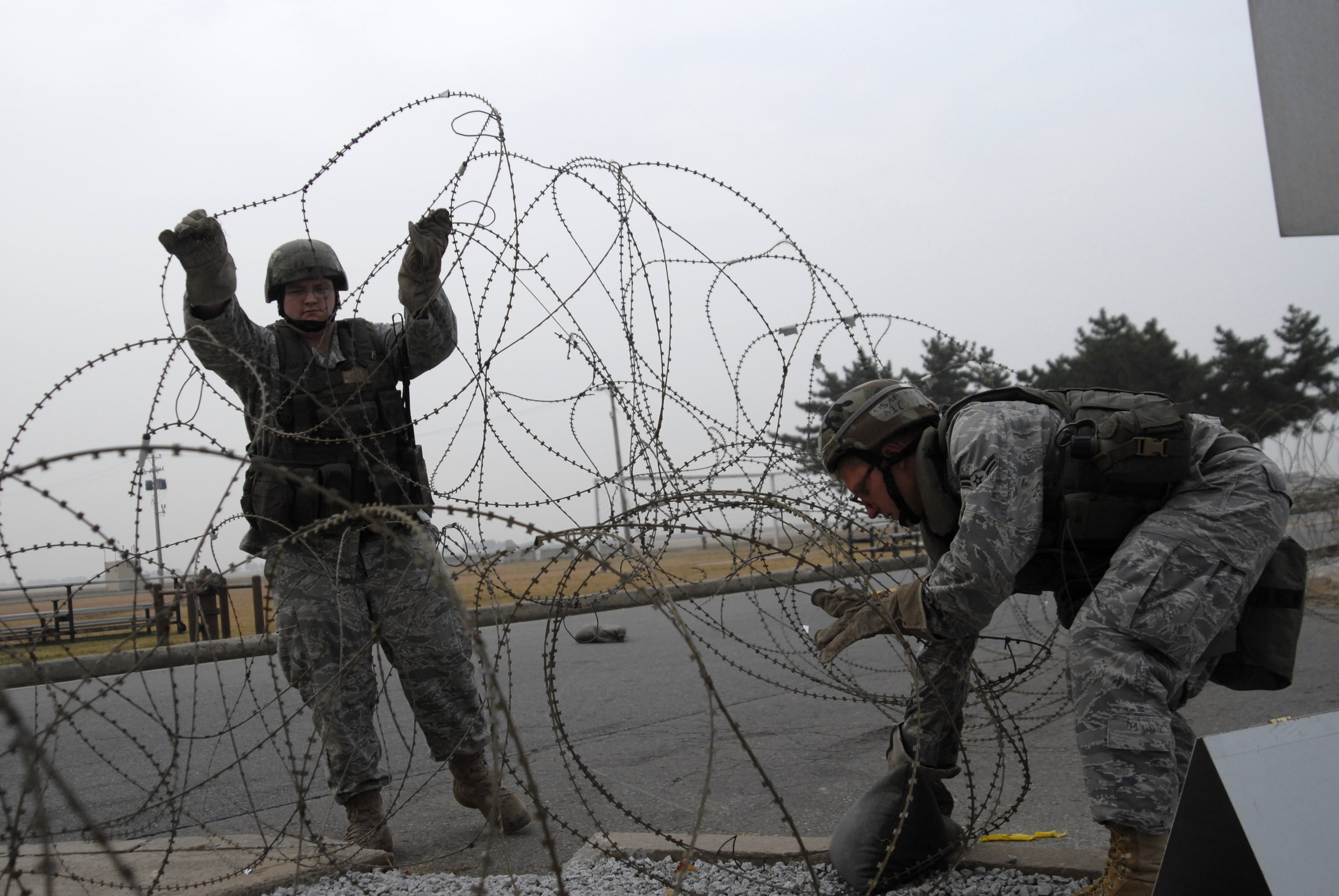 File:American soldier position concertina wire.jpg - Wikimedia Commons