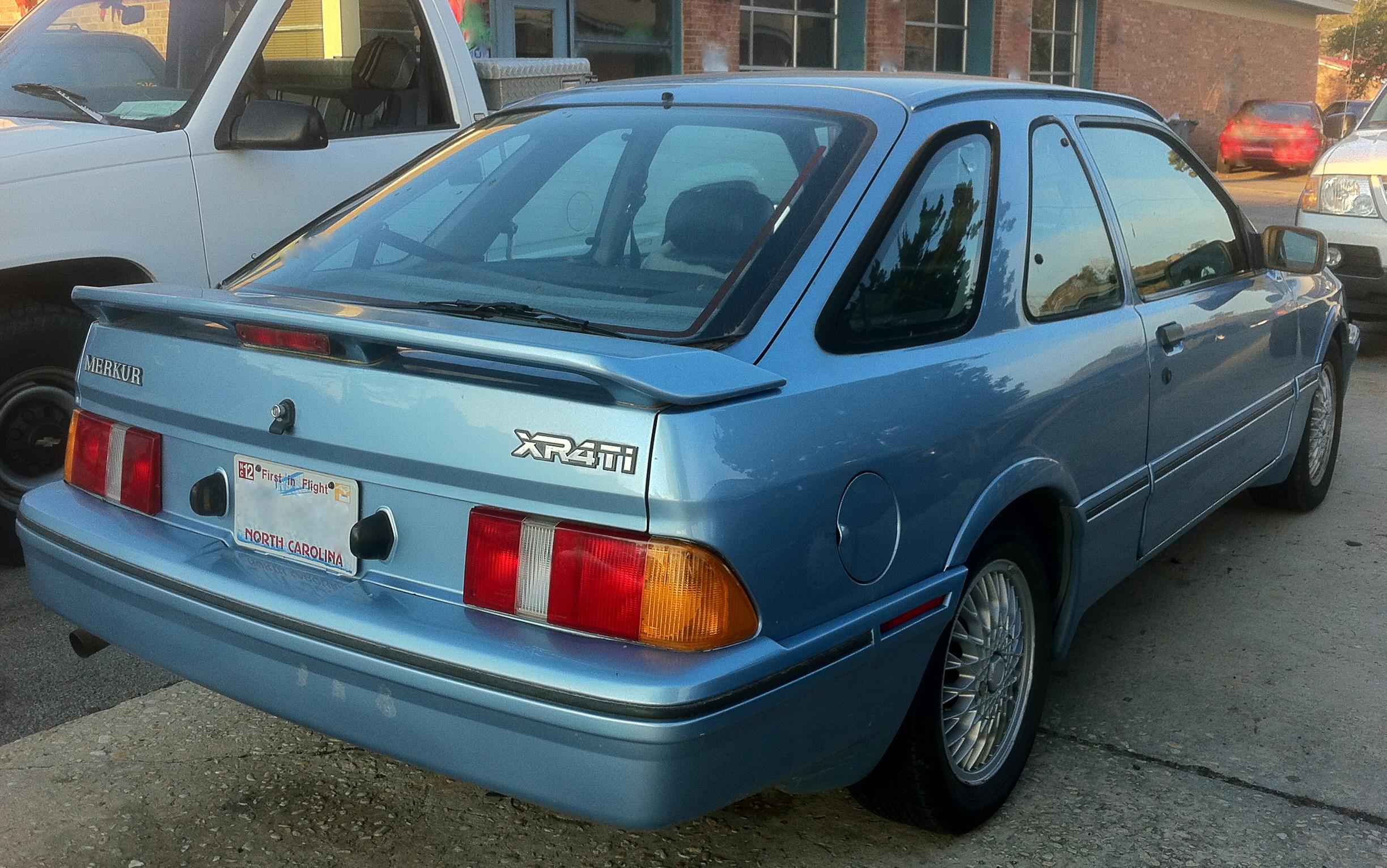 Used Cars In Usa >> File:Ford Merkur XR4Ti hatchback blue SOP.jpg - Wikimedia Commons