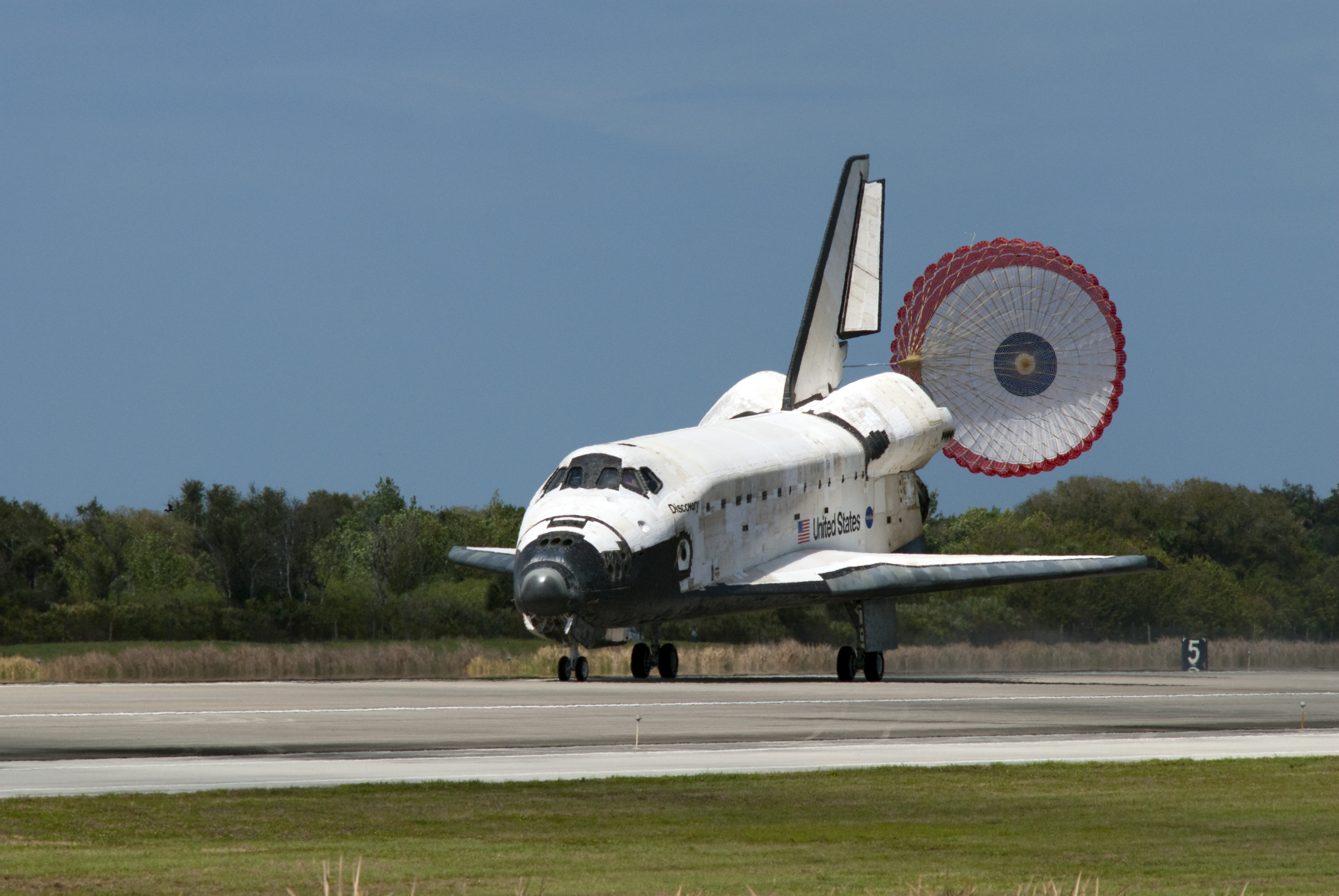 Description sts 133 landing at kennedy space center 19